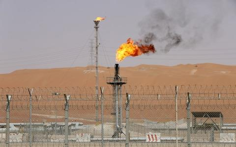 Flames are seen at the production facility of Saudi Aramco's Shaybah oilfield in the Empty Quarter, Saudi Arabia  - Credit: Ahmed Jadallah/ REUTERS