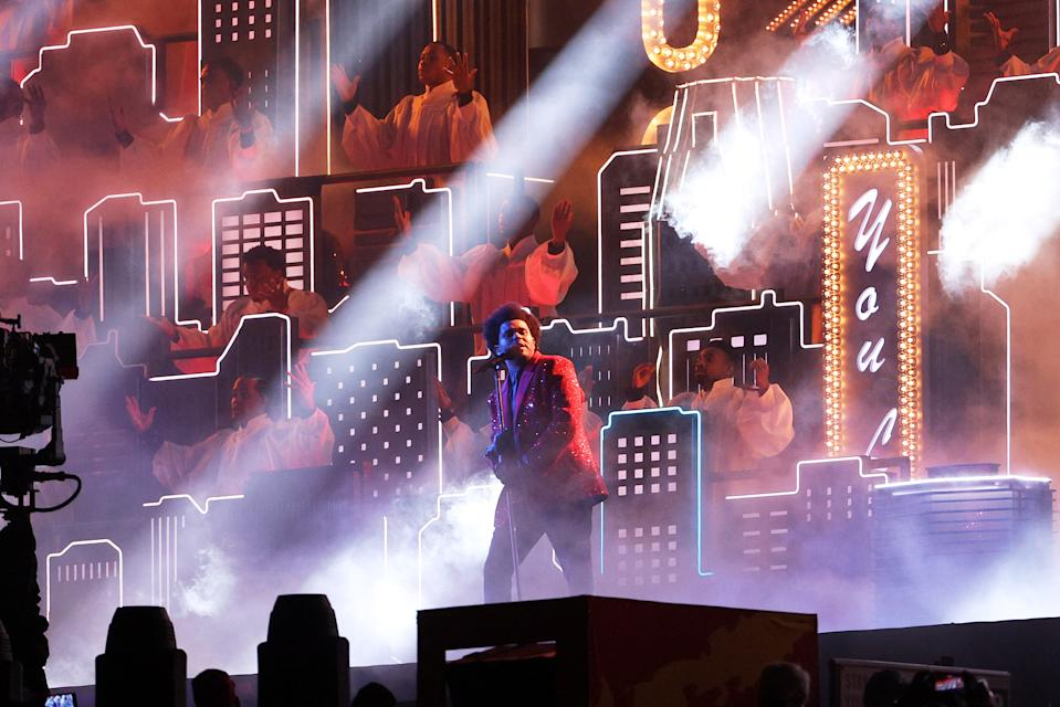 <p>TAMPA, FLORIDA - FEBRUARY 07: The Weeknd performs during the Pepsi Super Bowl LV Halftime Show at Raymond James Stadium on February 07, 2021 in Tampa, Florida. (Photo by Patrick Smith/Getty Images)</p>