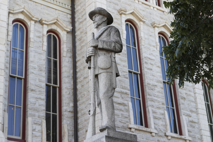 FILE - In the July 31, 2020 file photo a statue of a Confederate soldier sits outside the Parker County Courthouse in Weatherford, Texas. As a racial justice reckoning continues to inform conversations across the country, lawmakers nationwide are struggling to find solutions to thousands of icons saluting controversial historical figures. (AP Photo/Tony Gutierrez, File)
