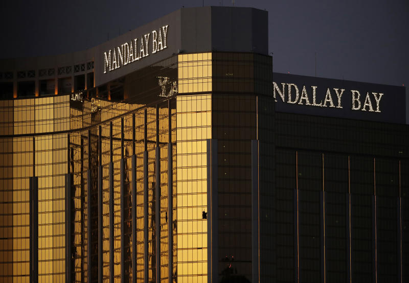 FILE - In this Oct. 3, 2017, file photo, windows are broken at the Mandalay Bay resort and casino in Las Vegas, the room from where Stephen Craig Paddock fired on a nearby music festival, killing 58 and injuring hundreds on Oct. 1, 2017. Federal District Judge Andrew Gordon wants Nevada's highest court to tell him whether gun manufacturers and sellers can be held liable under state law for negligence and wrongful death in the case of a Seattle woman killed in the Las Vegas Strip mass shooting in 2017. (AP Photo/John Locher, File)