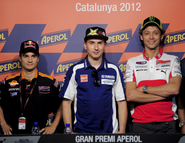 (FromL) Repsol Honda Team's Spanish Jorge Lorenzo, Yamaha Factory Racing's Spanish Jorge Lorenzo and Ducati Team's Italian Valentino Rossi pose during a press conference at the Catalunya racetrack in Montmelo, near Barcelona, on May 31, 2012, on eve of the Catalunya Moto GP Grand Prix training sessions. AFP PHOTO / JOSEP LAGOJOSEP LAGO/AFP/GettyImages