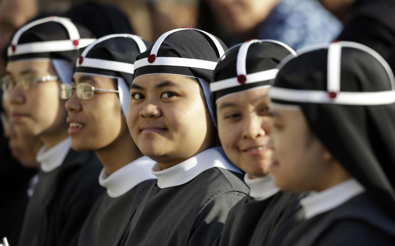 A group of nuns from the Philippines wait for the start of a canonization ceremony celebrated by Pope Benedict XVI, in St. Peter's Square, at the Vatican, Sunday, Oct. 21, 2012. The pontiff will canonize seven people, Kateri Tekakwitha, Maria del Carmen, Pedro Calungsod, Jacques Berthieu, Giovanni Battista Piamarta, Mother Marianne Cope, and Anna Shaeffer. (AP Photo/Andrew Medichini)