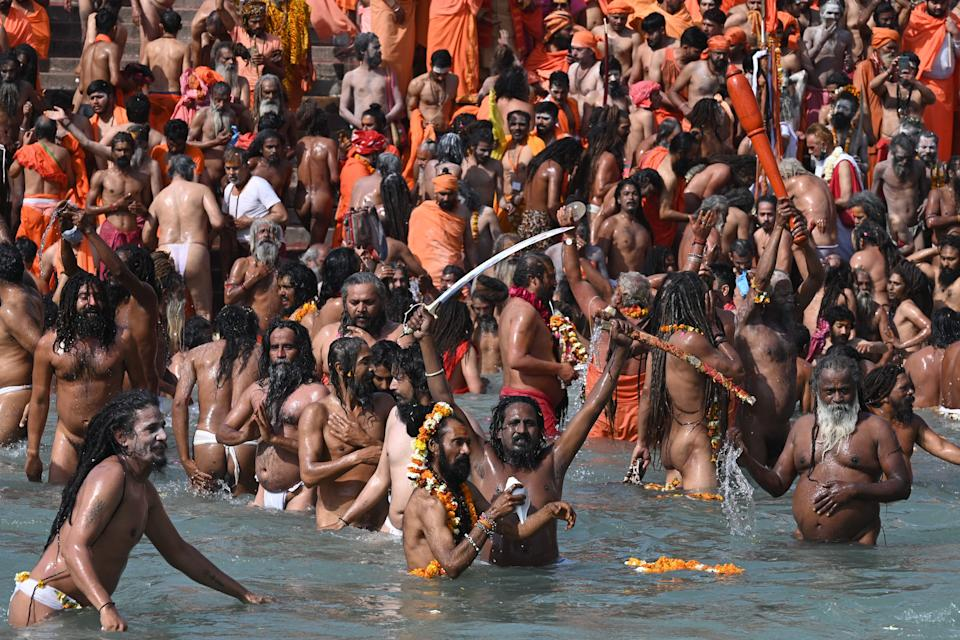 Naga Sadhus (Hindu holy men) take holy dip in the waters of the River Ganges on the Shahi snan (grand bath) on the occasion of Maha Shivratri festival during the ongoing religious Kumbh Mela festival in Haridwar on March 11, 2021. (Photo by Prakash SINGH / AFP) (Photo by PRAKASH SINGH/AFP via Getty Images)