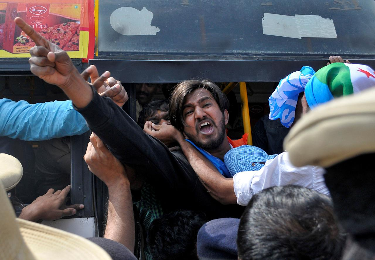 People chant slogans as they are detained by police during a protest organised by India's main opposition Congress party against demonetisation in Bengaluru, India, January 19, 2017. REUTERS/ Abhishek N. Chinnappa