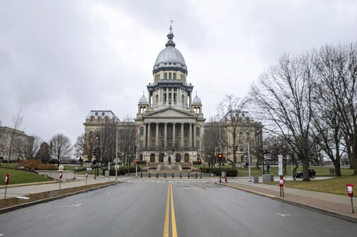 Parking spots around the perimeter of the Illinois State Capitol have been blocked off for possible protests.