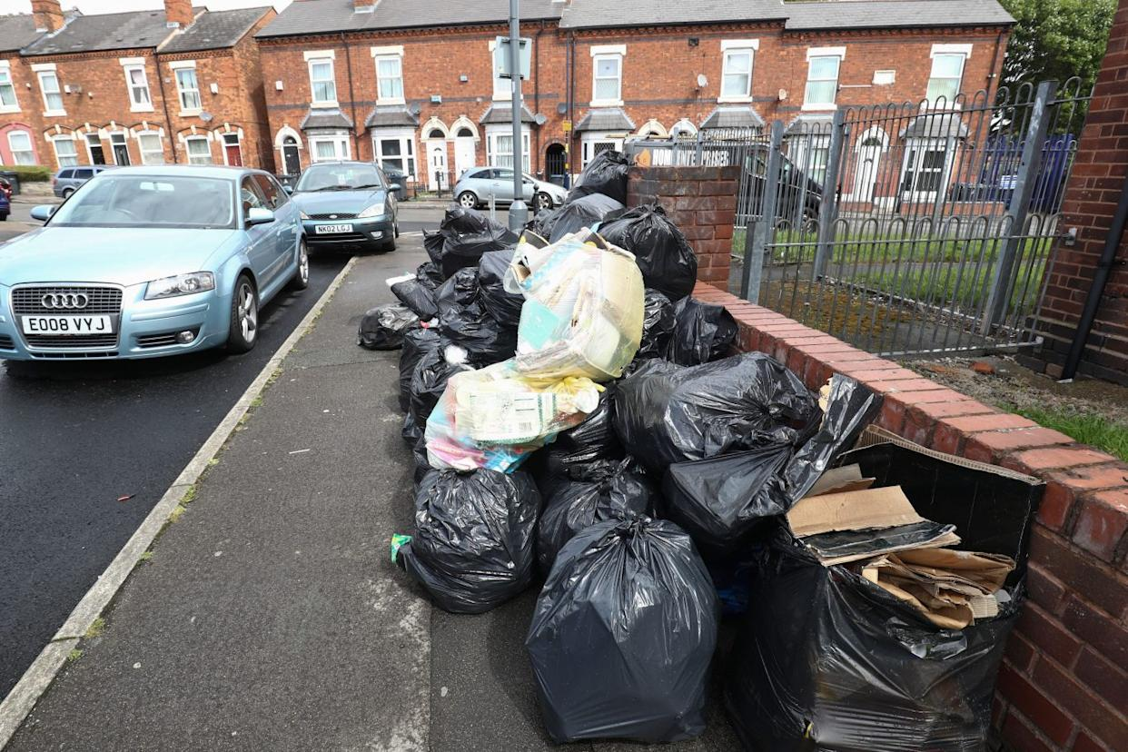 Rubbish bags piled high in Tarry Road, Birmingham (Aaron Chown/PA)