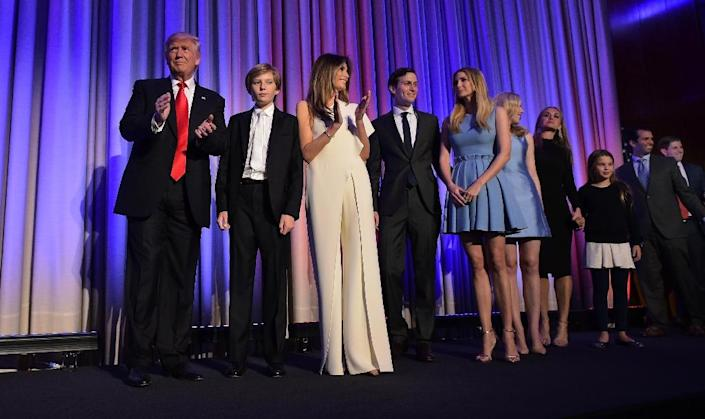 The Trumps, America's super-rich new first family, are a tight-knit celebrity clan (AFP Photo/MANDEL NGAN)