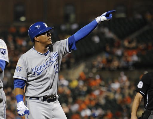 Kansas City Royals' Salvador Perez (13) celebrates his two-run home run against the Baltimore Orioles during the second inning of a baseball game, Saturday, Aug. 11, 2012, in Baltimore. (AP Photo/Nick Wass)