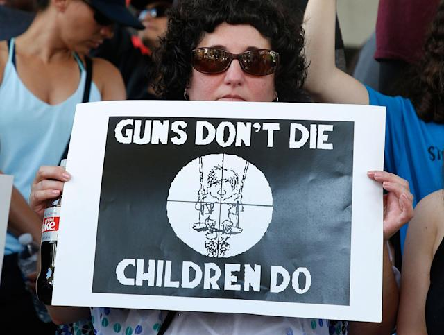 <p>Protesters hold signs at a rally for gun control at the Broward County Federal Courthouse in Fort Lauderdale, Fla., Feb. 17, 2018. (Photo: Rhona Wise/AFP/Getty Images) </p>