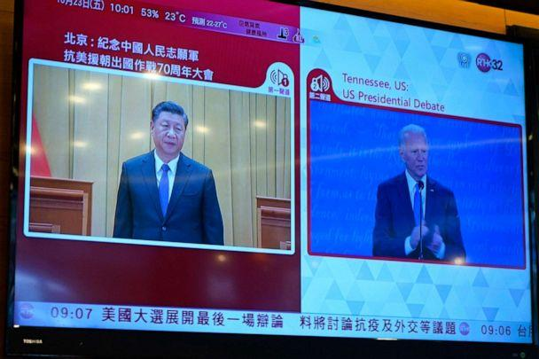 PHOTO: A TV screen broadcasts Chinese President Xi Jinpin speaking at an event and U.S. Democratic presidential candidate former Vice President Joe Biden speaking at the U.S. presidential debate, at a restaurant in Hong Kong, Oct. 23, 2020. (Kin Cheung/AP)