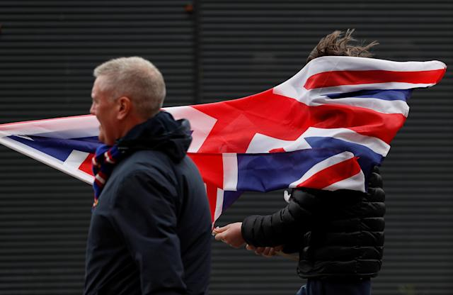 Soccer Football - Scottish Cup Semi Final - Celtic vs Rangers - Hampden Park, Glasgow, Britain - April 15, 2018 Fan with a flag outside the stadium before the match Action Images via Reuters/Lee Smith