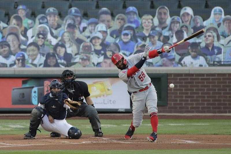 Los Angeles Angels' Jo Adell (59) hits a single in his first major-league at-bat during the first inning of a baseball game against the Seattle Mariners, Tuesday, Aug. 4, 2020, in Seattle. (AP Photo/Ted S. Warren)