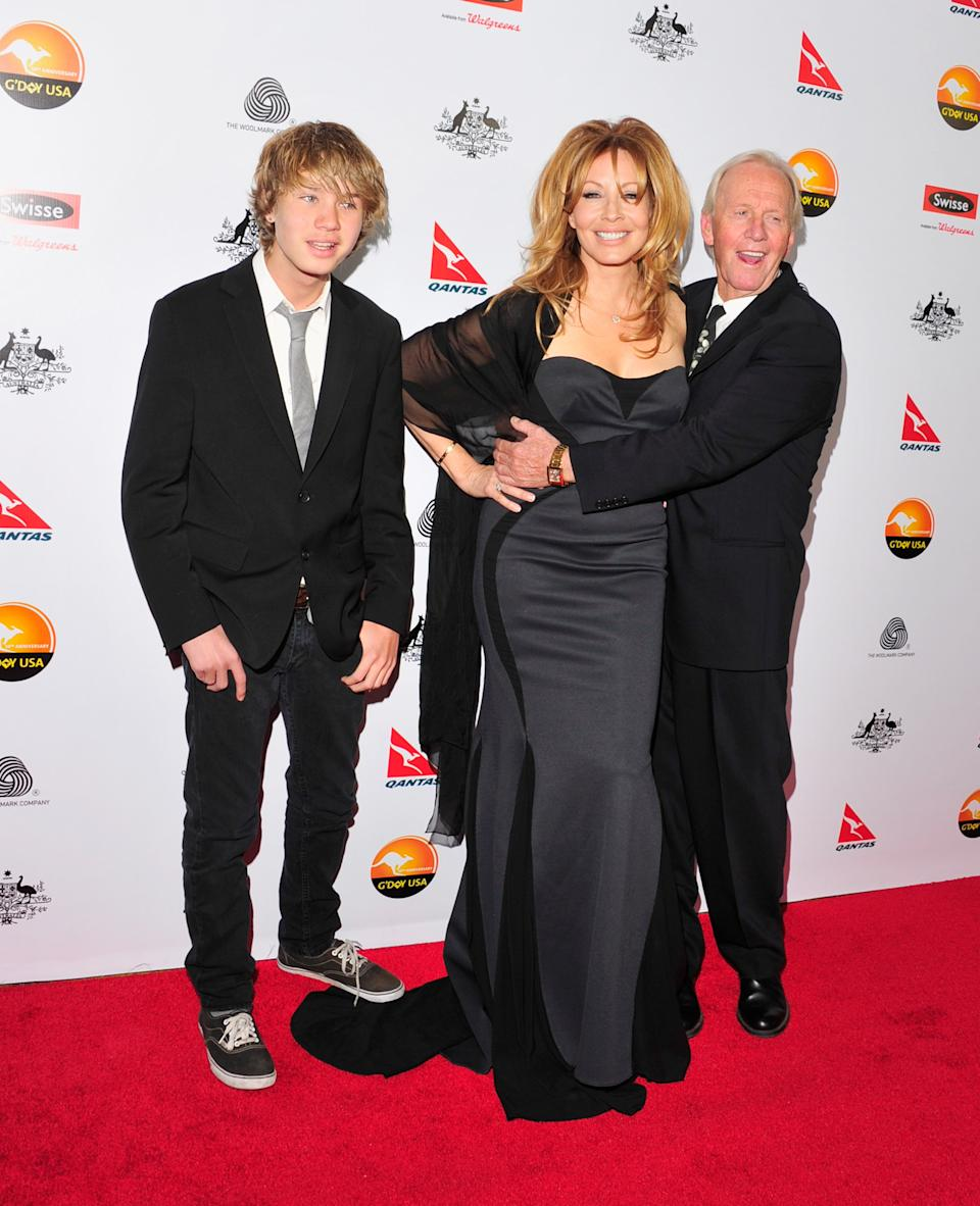 L-R Chance Hogan, Linda Kozlowski and actor Paul Hogan arrive for the G'Day USA Black Tie Gala held at at the JW Marriot at LA Live on January 12, 2013 in Los Angeles, California.  (Photo by Mark Sullivan/Getty Images)