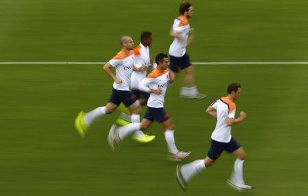 Netherlands'sVan Persie and Vlaar run with teammates during a training session in Rio de Janeiro