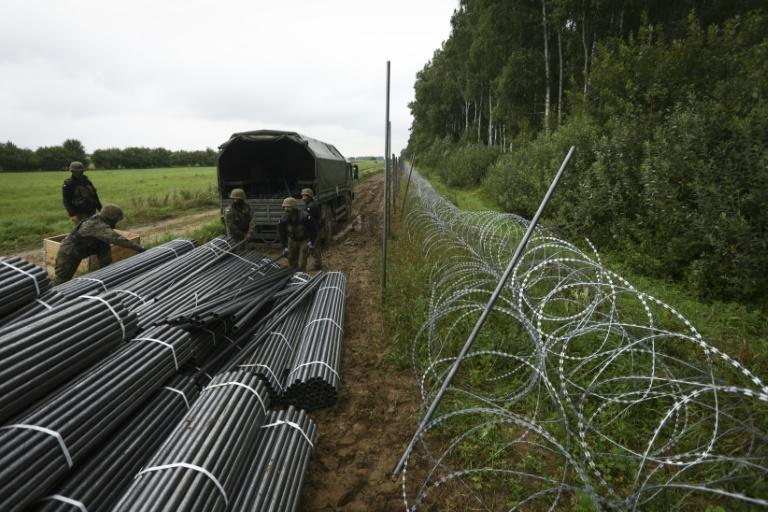 Poland is refusing to let in a group of around 30 migrants camped out on the border with Belarus (AFP/Jaap Arriens)