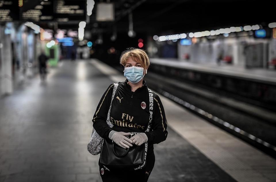 A commuter wearing a protective facemask and gloves waits on the deserted platform at the Auber metro station in Paris on April 9, 2020, on the twenty-fourth day of a lockdown in France to attempt to halt the spread of the novel coronavirus COVID-19. (Photo by STEPHANE DE SAKUTIN / AFP) (Photo by STEPHANE DE SAKUTIN/AFP via Getty Images)