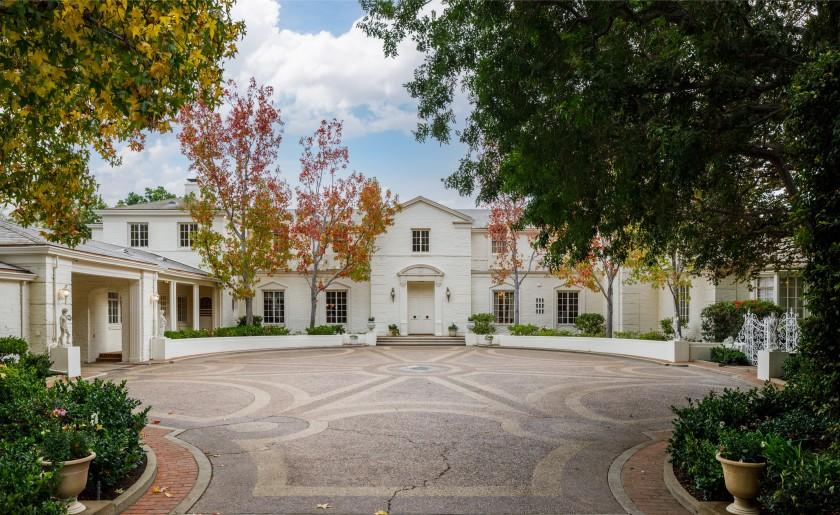 Spanning 2.5 acres, the property includes a sunken tennis court, a famous Zodiac pool and a Georgian-style mansion with more than 15,000 square feet.