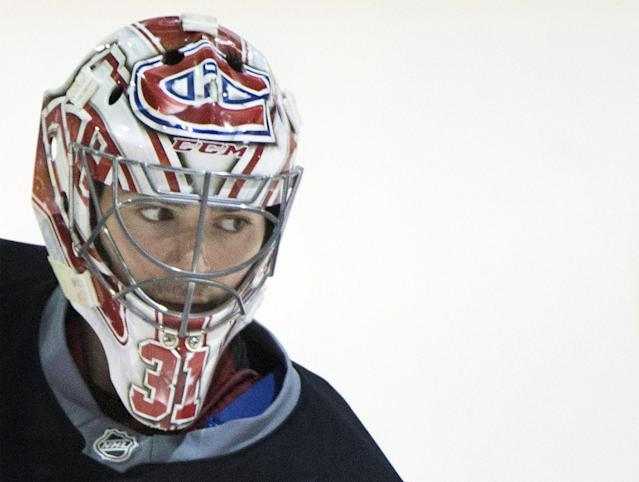 Monreal Canadiens' goaltender Carey Price looks down the ice during a practice session in Brossard, Quebec, Monday, April 21, 2014, ahead of game four of first-round NHL Stanley Cup playoff game against the Tampa Bay Lightning. The Canadiens lead the series 3-0. (AP Photo/The Canadian Press, Graham Hughes)