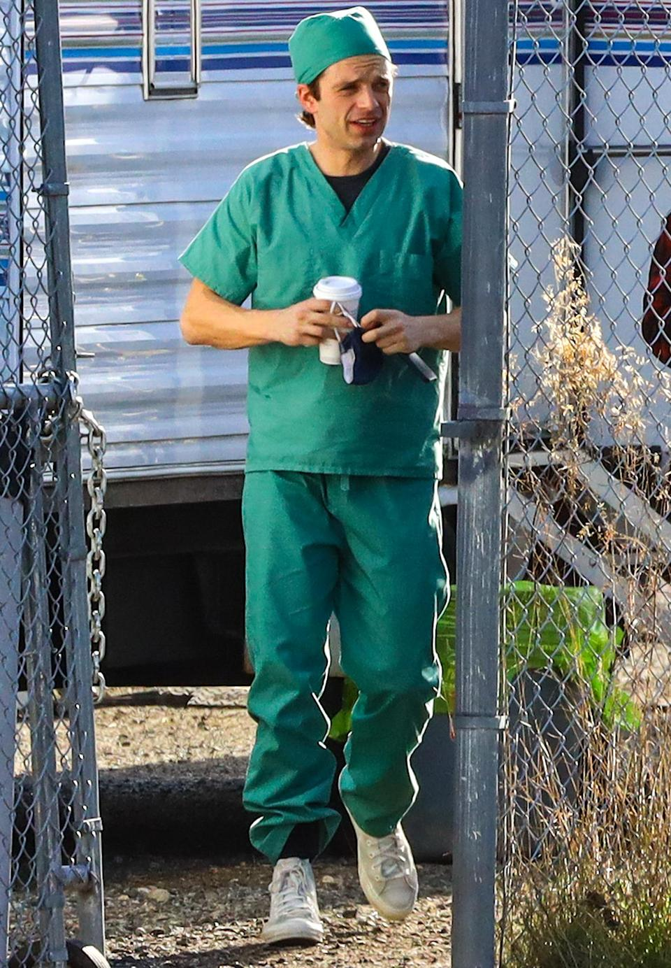 <p>Sebastian Stan heads to the set of <em>Fresh</em> on Wednesday in Vancouver, wearing green scrubs and white sneakers.</p>