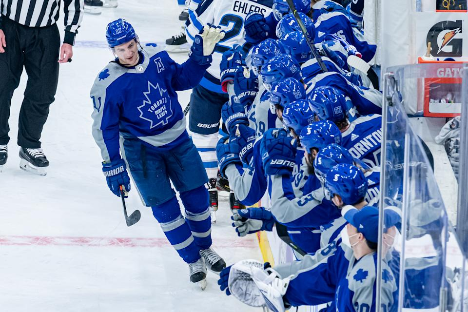 TORONTO, ON - MARCH 09: Toronto Maple Leafs Left Wing Zach Hyman (11) celebrates his goal by the team bench during the NHL regular season game between the Winnipeg Jets and the Toronto Maple Leafs on March 9, 2021, at Scotiabank Arena in Toronto, ON, Canada. (Photo by Julian Avram/Icon Sportswire via Getty Images)