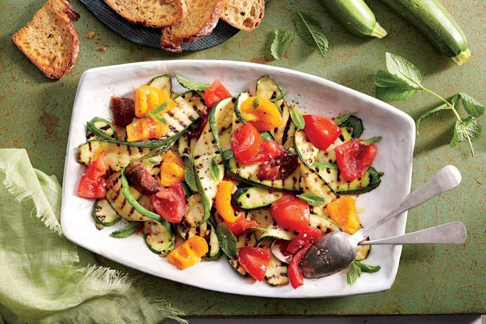 """<p><strong>Recipe: <a href=""""https://www.southernliving.com/recipes/grilled-zucchini-tomatoes-mint-recipe"""" rel=""""nofollow noopener"""" target=""""_blank"""" data-ylk=""""slk:Grilled Zucchini with Tomatoes and Mint"""" class=""""link rapid-noclick-resp"""">Grilled Zucchini with Tomatoes and Mint</a></strong></p> <p>Following the phrase """"what grows together goes together"""" gave us this combination of fresh grilled veggies and mint. </p>"""