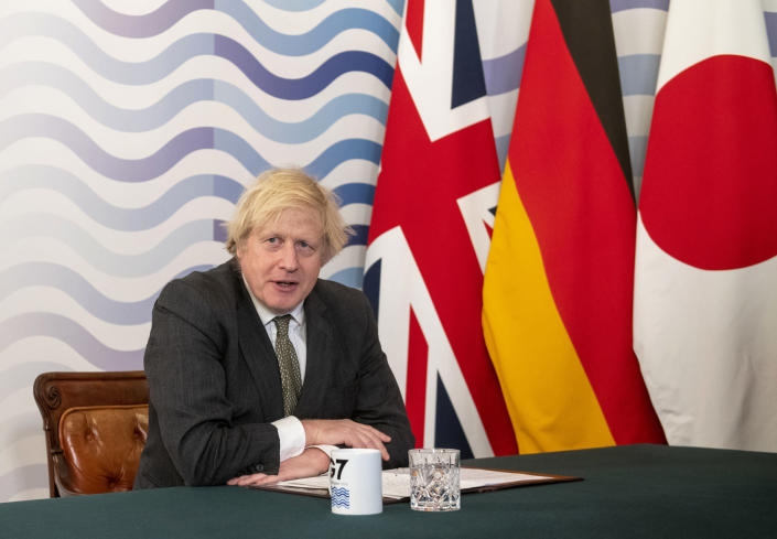 Britian's Prime Minister Boris Johnson hosts a virtual meeting of G7 world leaders, from within the Cabinet Room at Downing Street in London, Friday Feb. 19, 2021. Johnson is chairing a virtual meeting Friday with leaders of the Group of Seven economic powers, holding their first meeting of 2021. (Geoff Pugh/Pool via AP)