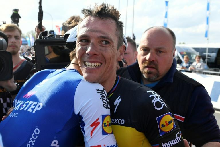 Belgian cyclist Philippe Gilbert (centre) is congratulated by Dutch rival Niki Terpstra after the Tour of Flanders, a 260km from Antwerp to Oudenaarde, on April 2, 2017