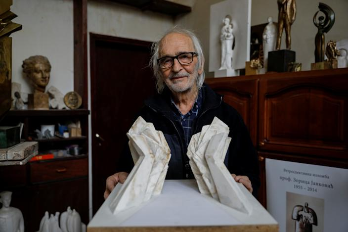 """Miodrag Zivkovic, 91, architect of the """"Battle of Sutjeska"""" memorial monument, with the original maquette in his home in Belgrade, Serbia. Zivkovic, the sculptor of the 19-meter-high concrete Tjentiste memorial was among the first artists in the former Yugoslavia to use concrete. """"It is stable material, resembling stone, but it is easier to work with,"""" he said. """"For every project back in those days there was a national contest, and artists from all over the country had the opportunity to apply, and that competition produced quality."""" (Photo: Marko Djurica/Reuters)"""