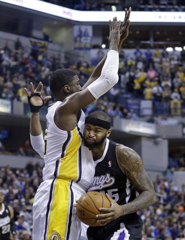 Sacramento Kings center DeMarcus Cousins, right, crashes into Indiana Pacers center Roy Hibbert in the first half of an NBA basketball game in Indianapolis, Tuesday, Jan. 14, 2014. (AP Photo/Michael Conroy)