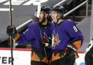 Arizona Coyotes' Jordan Oesterle (82) celebrates with Clayton Keller (9) after he scored against the Colorado Avalanche during the second period of an NHL hockey game Saturday, Feb. 27, 2021, in Glendale, Ariz. (AP Photo/Darryl Webb)