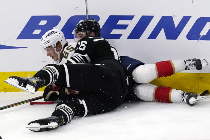Florida Panthers defenseman Markus Nutivaara (65) is checked by Chicago Blackhawks defenseman Nikita Zadorov (16) during the second period of an NHL hockey game in Chicago, Saturday, May 1, 2021. (AP Photo/Nam Y. Huh)