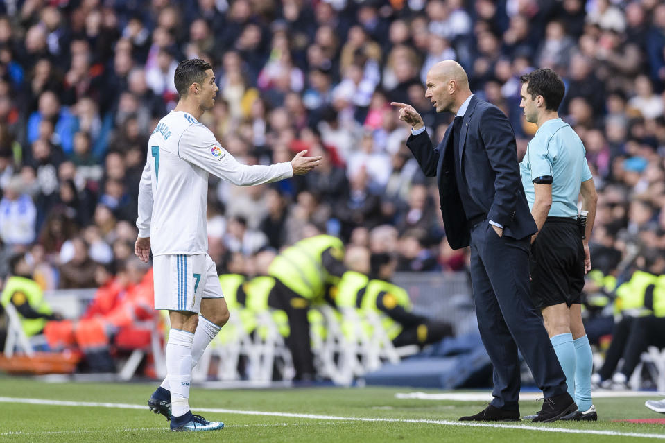 MADRID, SPAIN - DECEMBER 09: Zinedine Zidane Head Coach of Real Madrid (R) instructs Cristiano Ronaldo of Real Madrid (L) during La Liga 2017-18 match between Real Madrid and Sevilla FC at Santiago Bernabeu Stadium on 09 December 2017 in Madrid, Spain. (Photo by Power Sport Images/Getty Images)