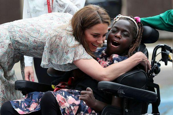 PHOTO: Britain's Kate, Duchess of Cambridge hugs Faith Olukoya at a photography workshop for Action for Children, run by the Royal Photographic Society in Kingston, England, June 25, 2019. (Chris Jackson/Pool via AP)