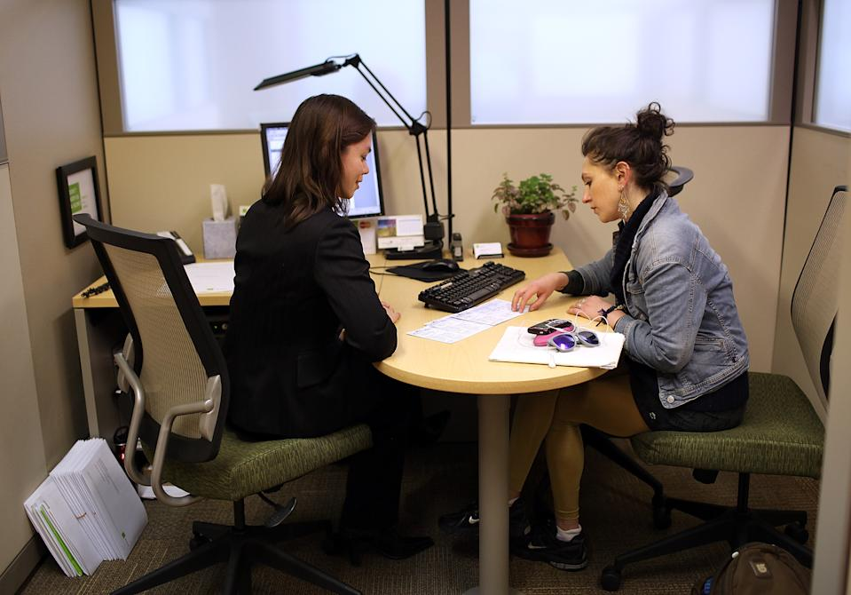 H & R Block tax preparer Catherine Roman (L) helps Clair Czarecki (R) with her taxes at an H & R Block office on April 15, 2011 in San Francisco, California. (Photo: Justin Sullivan/Getty Images)