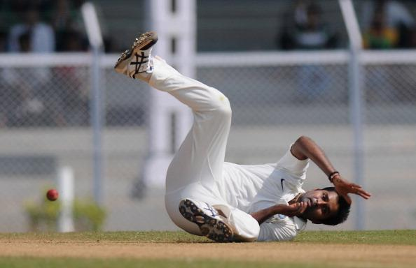 MUMBAI, INDIA - OCTOBER 31:  Vinay Kumar of  India A tries to stop a ball of his own bowling during the second day of the first practice match between England and India A at the CCI (Cricket Club of India) ground,  on October 31, 2012 in Mumbai, India.  England will play three practice matches before the start of four test series  (Photo by Pal Pillai/Getty Images)