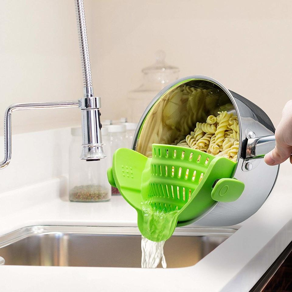 """Made of sturdy BPA-free silicone, this strainer will make it so you can drain your pasta one-handed!<br /><br /><strong>Promising review:</strong>""""I cannot say enough good about this strainer. It fits all my pots from small to huge, even frying pans! I have strainers, colanders, every kind of lid converter...this strainer is the best ever. When the pot is too heavy for me to hold to drain off the water, with this I can still hold on with both hands, and then when it is mostly drained, I set the pot in the sink to continue to drain (fidgety pastas)<strong>Washes up like a dream, or toss in the dishwasher. I do not know how I lived without this strainer. Now I can get rid of probably 20 items out of my kitchens!</strong>"""" —<a href=""""https://www.amazon.com/dp/B018W9JII0?tag=huffpost-bfsyndication-20&ascsubtag=5883859%2C28%2C54%2Cd%2C0%2C0%2C0%2C962%3A1%3B901%3A2%3B900%3A2%3B974%3A3%3B975%3A2%3B982%3A2%2C16464252%2C0"""" target=""""_blank"""" rel=""""noopener noreferrer"""">SGA</a><br /><strong><br />Get it from Amazon for<a href=""""https://www.amazon.com/dp/B018W9JII0?tag=huffpost-bfsyndication-20&ascsubtag=5883859%2C28%2C54%2Cd%2C0%2C0%2C0%2C962%3A1%3B901%3A2%3B900%3A2%3B974%3A3%3B975%3A2%3B982%3A2%2C16464252%2C0"""" target=""""_blank"""" rel=""""noopener noreferrer"""">$15.99</a>(available in five colors).</strong>"""