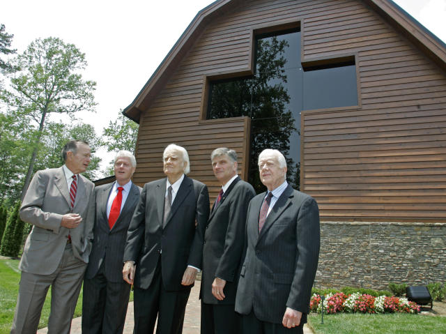 <p>Former presidents including, from left, George H.W. Bush, Bill Clinton, second left, and Jimmy Carter, right, join Franklin Graham, second right, as they pose with Billy Graham, center, in front of the Billy Graham Library in Charlotte, N.C., on May 31, 2007 during the dedication ceremony. The 40,000-square-foot complex, built near the Billy Graham Evangelistic Association, traces the preacher's rise from farm boy to the most widely heard minister of all time, having preached the Gospel in person to more than 210 million people over his long career. (Photo: Chuck Burton/AP) </p>