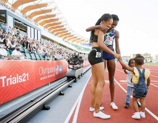 PHOTO:Allyson Felix and Quanera Hayes celebrate with their children after placing second and first respectively in the Women's 400 Meters Final on day three of the 2020 U.S. Olympic Track & Field Team Trials at Hayward Field,June 20, 2021, in Eugene, Ore. (Steph Chambers/Getty Images)
