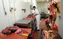 A horse butcher cuts pieces of horse meat at a butchery in Valenciennes, France, on February 22, 2013. Britain alerted Paris that six tainted carcasses had been exported to France in January, but the meat had already been processed by the time the warning came, the spokesman said
