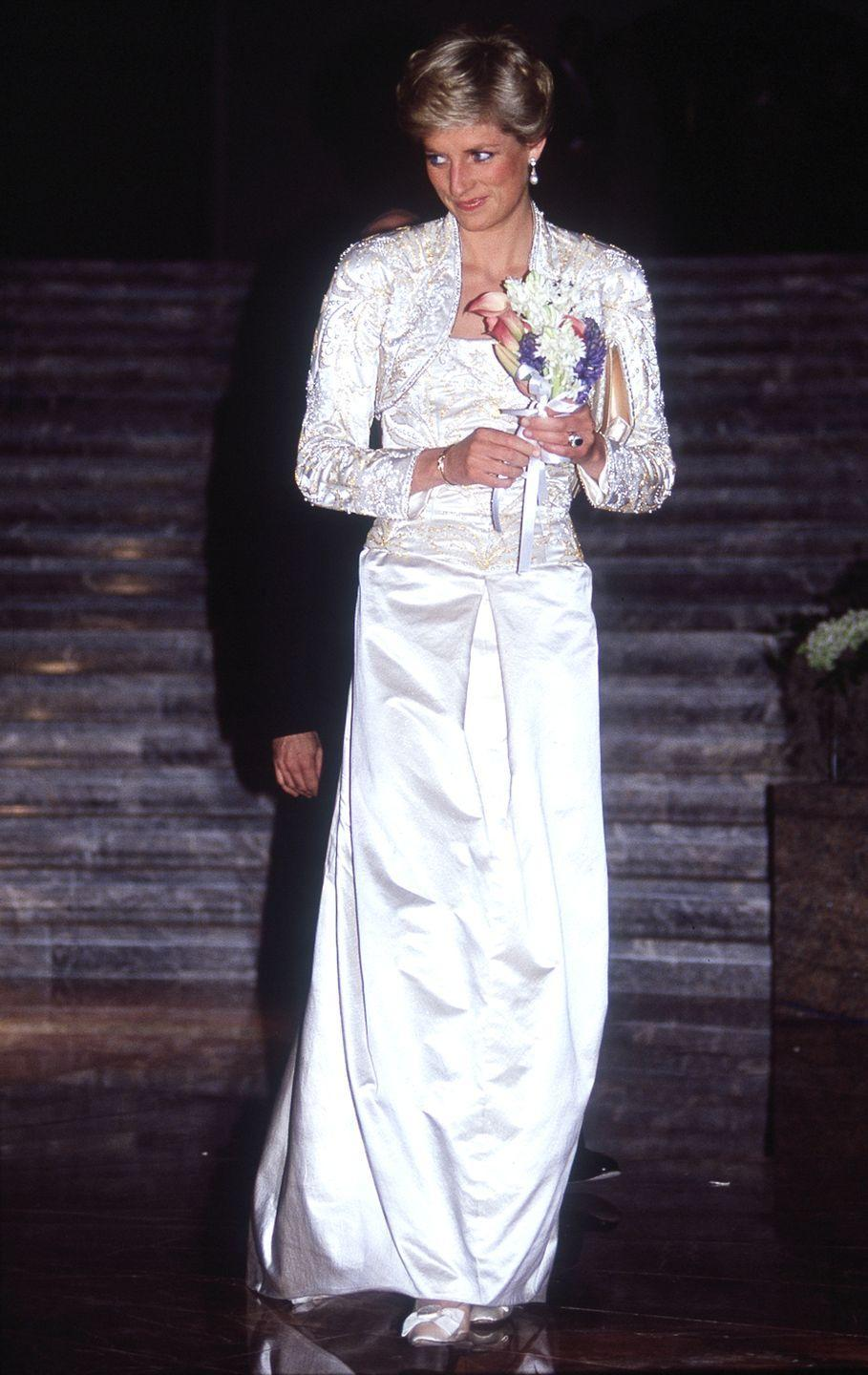 <p>Diana's look at the BAM gala was by far her most memorable of the trip—a stunning and super of-its-era Victor Edestein gown paired with a matching jacket.</p>
