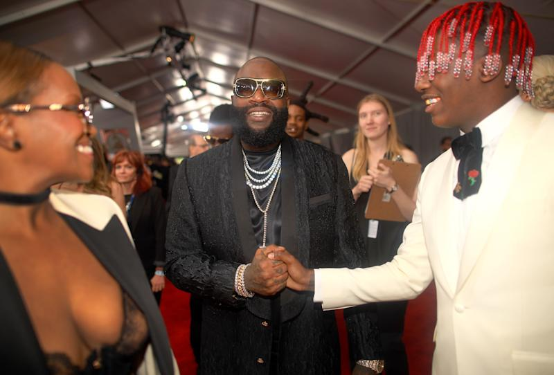LOS ANGELES, CA - FEBRUARY 12: Rapper Rick Ross (C) and Lil Yachty (R) attend The 59th GRAMMY Awards at STAPLES Center on February 12, 2017 in Los Angeles, California. (Photo by Christopher Polk/Getty Images for NARAS)