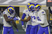 Los Angeles Rams' Van Jefferson (12) celebrates his touchdown catch from quarterback Jared Goff (16) during the first half of an NFL divisional playoff football game against the Green Bay Packers, Saturday, Jan. 16, 2021, in Green Bay, Wis. (AP Photo/Mike Roemer)