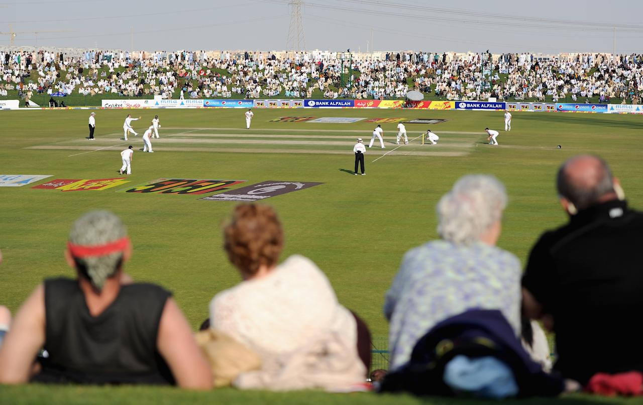 ABU DHABI, UNITED ARAB EMIRATES - JANUARY 27:  The crowd watch as Graeme Swann of England bowls to Asad Shafiq during the second Test match between Pakistan and England at Sheikh Zayed Stadium on January 27, 2012 in Abu Dhabi, United Arab Emirates.  (Photo by Gareth Copley/Getty Images)