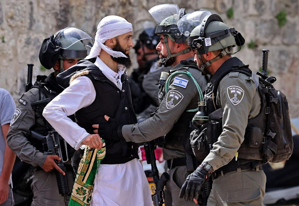 A Palestinian argues with Israeli security forces in Jerusalem's Old CityAFP/Getty