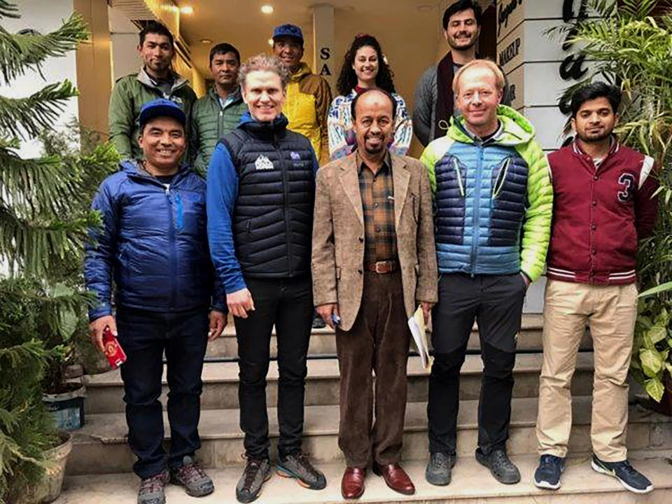 In this Jan. 8, 2020, photo provided by Alpine Club of Pakistan, Iceland's mountaineer John Snorri, second left in front row, and his team members pose for photograph with Karrar Haider, a top official of Alpine Club of Pakistan, center in front row, after a meeting, in Islamabad, Pakistan. An aerial search mission is on to find three experienced climbers, Ali Sadpara and his two companions, John Snorri and Juan Pablo Mohr, who lost contact with the base camp during their ascend on world's second top peak in northern Pakistan, official said Sunday, Feb. 7, 2021. (Alpine Club of Pakistan via AP)