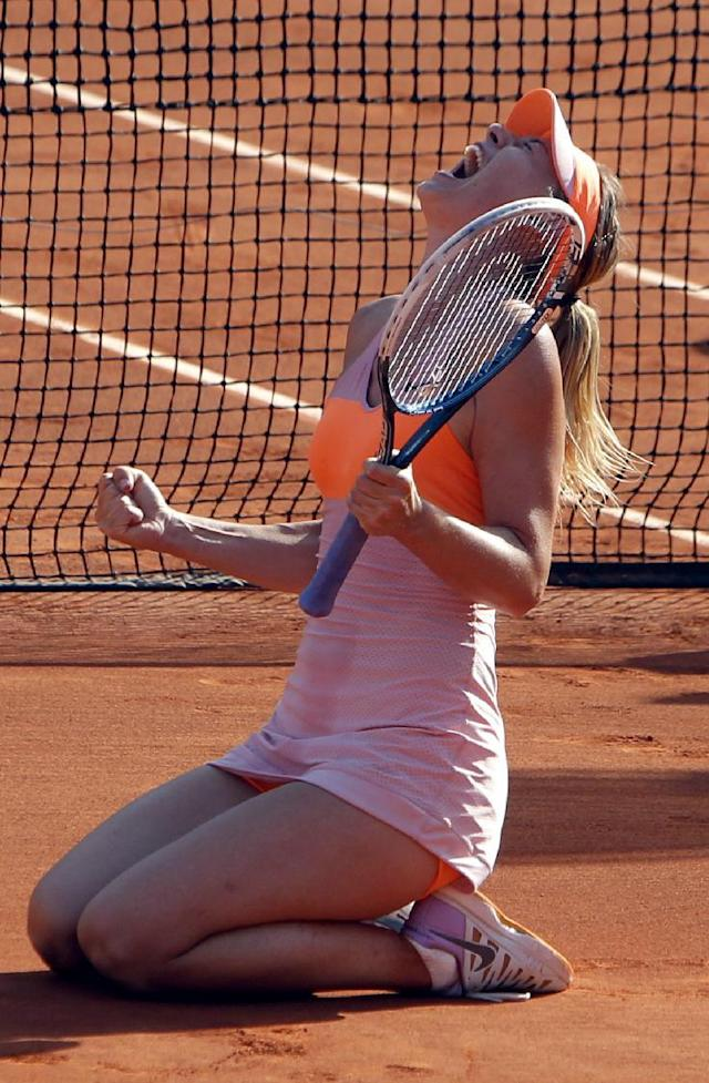 Russia's Maria Sharapova reacts after defeating Romania's Simona Halep in their final match of the French Open tennis tournament at the Roland Garros stadium, in Paris, France, Saturday, June 7, 2014. (AP Photo/Thibault Camus)