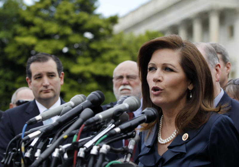 Rep. Michele Bachmann, R-Minn. chair of the Tea Party Caucus, speaks on Capitol Hill in Washington, Thursday, May 16, 2013, during a news conference with Tea Party leaders to discuss the IRS targeting Tea Party groups. Sen. Ted Cruz, R-Texas is at left. Dozens of tea party groups and other conservative organizations of the kind subjected to improper scrutiny by the Internal Revenue Service operated with small budgets and rarely displayed overt partisan activities, according to an Associated Press review of public tax filings by 93 such activist groups. A few groups built million-dollar operations and political ties that could have been legitimate grounds for IRS investigation, tax law experts said. (AP Photo/Molly Riley)