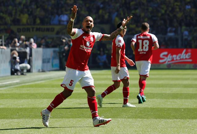 Soccer Football - Bundesliga - Borussia Dortmund vs 1.FSV Mainz 05 - Signal Iduna Park, Dortmund, Germany - May 5, 2018 Mainz's Nigel de Jong celebrates after Bote Baku (not pictured) scored their first goal REUTERS/Leon Kuegeler DFL RULES TO LIMIT THE ONLINE USAGE DURING MATCH TIME TO 15 PICTURES PER GAME. IMAGE SEQUENCES TO SIMULATE VIDEO IS NOT ALLOWED AT ANY TIME. FOR FURTHER QUERIES PLEASE CONTACT DFL DIRECTLY AT + 49 69 650050