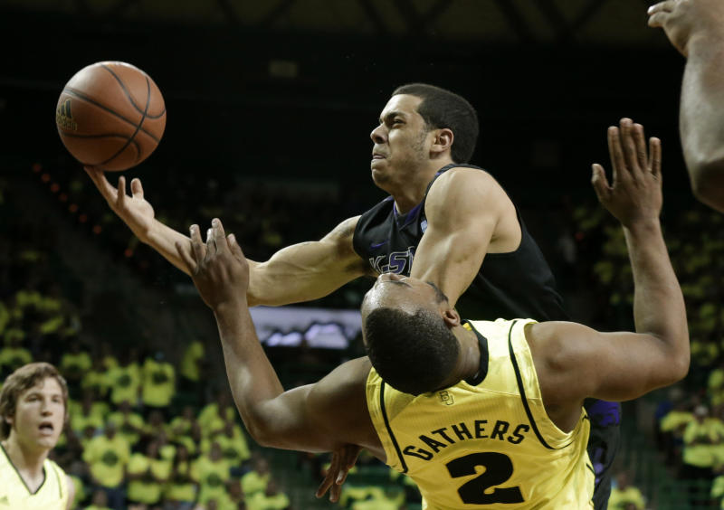 Baylor's Rico Gathers (2) takes a charge to the basket by Kansas State's Angel Rodriguez in the first half of an NCAA college basketball game on Saturday, March 2, 2013, in Waco, Texas. (AP Photo/Tony Gutierrez)
