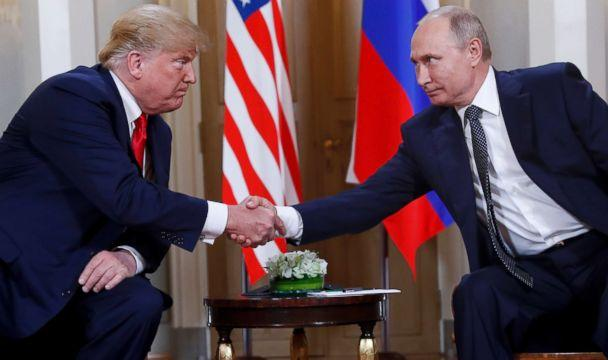 PHOTO: In this July 16, 2018, file photo, U.S. President Donald Trump, left, and Russian President Vladimir Putin shake hands at the beginning of a meeting at the Presidential Palace in Helsinki, Finland. (Pablo Martinez Monsivais/AP, FILE)